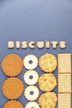 Biscuit word written wth biscuit letters, dark background