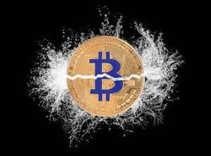 Bitcoin broken in half with water splash