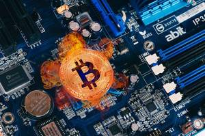 Bitcoin on fire on computer parts