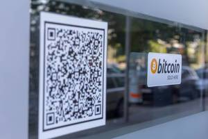 Bitcoin sold here and barcode stickers on a window