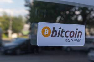 Bitcoin sold here sticker on a shop window