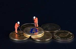 Bitcoins and miners on a black backgrund