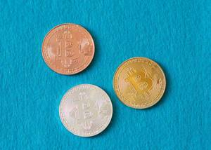 Bitcoins on a blue background