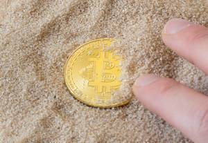 Bitcon in sand