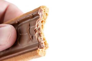 Biten Twix Top chocolate bar in the hand