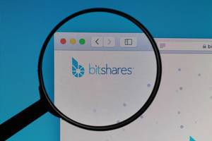 Bitshares logo under magnifying glass