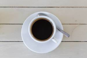 Black coffee (americano) on wooden  background