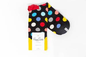 Black cotton socks with colorful dots on white background