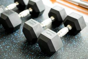 Black weight dumbbells in a sports studio