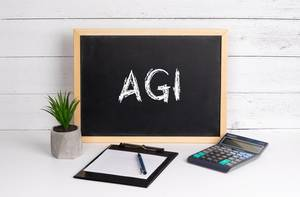 Blackboard with AGI text