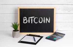 Blackboard with Bitcoin text