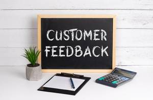 Blackboard with Customer Feedback text