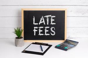 Blackboard with Late Fees text