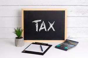Blackboard with Tax text