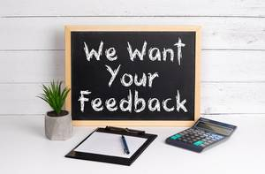 Blackboard with We Want Your Feedback text