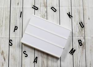 Blank lightbox sign on white wooden background