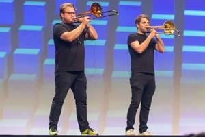Blasmusik mit Posaunenspieler auf der Bühne im Internationalen Congress Center in München