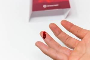 Bleeding finger after taking SARS-CoV-2 antibody test with fingerprick blood testing system