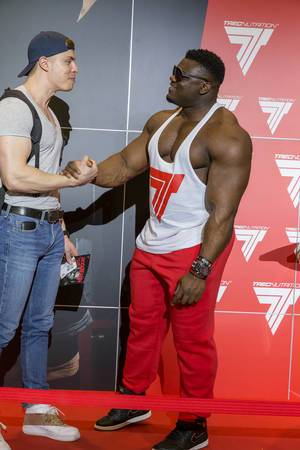 "Blessing ""The Boogieman"" Awodibu shaking hands with a fan - FIBO Cologne 2018"