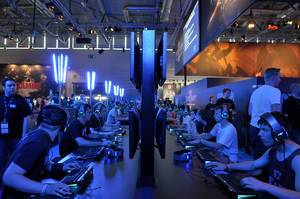 Blizzard gamescom fair stand with gamers aligned in two rows