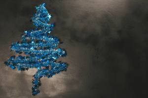 Blue Christmas tree on a dark background with free space (Flip 2019)