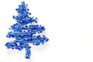 Blue christmas tree on white background with free space