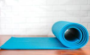 Blue fitness mat for meditation and sports accessories