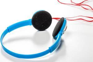 Blue headphones on white background (Flip 2019)