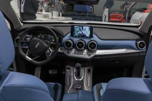 Blue interior of Nobo VV7 Concept Cabin, with black honeycomb intake grille and full LCD instruments