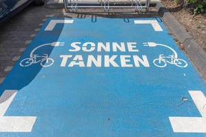 Blue Parking lot for electric bicycles / e-bikes at a German Aldi-Süd supermarket parking lot