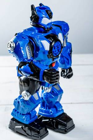 Blue robot toy on white background