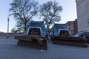 Blue snow plow trucks by Freightliner