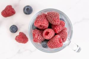 Blueberries and Raspberries in the glass
