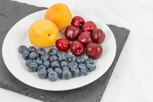 Blueberries Apricots and Cherries served on the plate (Flip 2019)