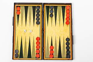 Board for playing backgammon with pieces and dice on a white background. Top view (Flip 2019)