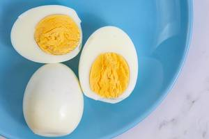 Boiled Chicken Eggs on the blue plate