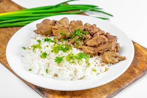 Boiled rice with chicken giblets and greens