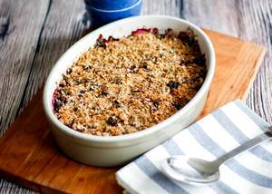 Bokeh Food Photo of Homemade Berry Crumbles on a Wooden Board with Spoon