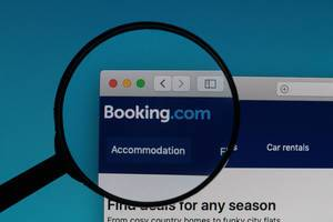 Booking.com in a browser and a magnifier