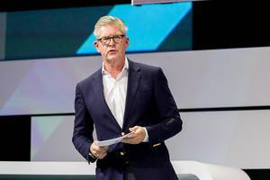 Börje Ekholm with speaker cards on stage of Digital X in Cologne