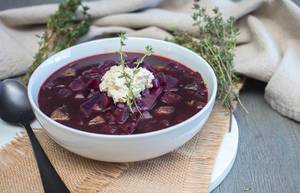 Borscht Soup In a White Bowl Top View With Thyme  Flip 2019