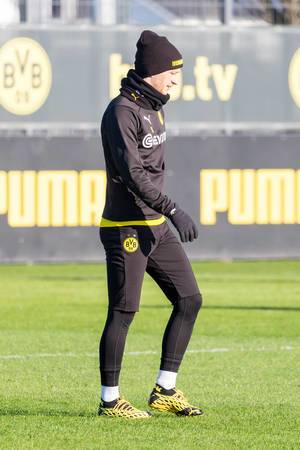 Borussia Dortmund captain Marco Reus in winter training clothes on a sunny day