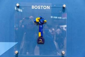 Boston Athletic Association 123 Boston Marathon Medal with blue-yellow ribbon