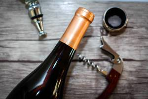Bottle of Wine with Opener and Accessories