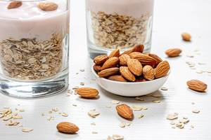 Bowl full of almonds and oatmeal porridge behind (Flip 2019)
