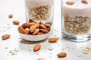 Bowl-full-of-almonds-and-oatmeal-porridge-behind.jpg