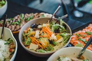 Bowl Of Camambert Cheese and Tangerine Salad With Greens