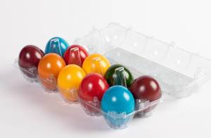Box full of painted Easter eggs on white background