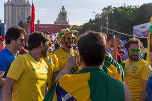 Brazilian soccer fans with goofy sunglasses and jester hats