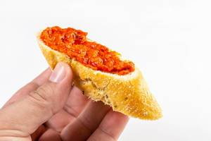 Bread Baguettes with Tomato and Tartar Sauce in the hand